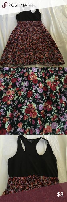 Wet seal racer back tank dress with floral Good condition. Easy weekend getaway sundress. Black tangier material top with ELASTICIZED waist and cute small cotton floral print bottom. 31 inches total length shoulder to hem Wet Seal Dresses