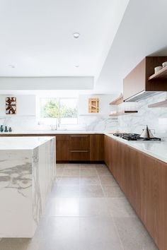 A before-and-after look inside the striking transformation of a one-of-a-kind marble kitchen space by Veneer Designs.