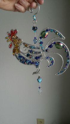 Rooster sun catcher #wirework #suncatcher #wirewrapped #wiresculpture #wiresuncatcher