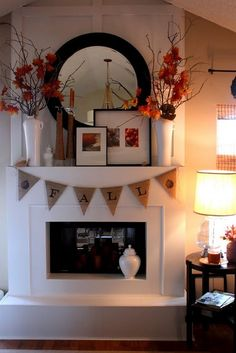 cardinalacre: I love the tall vases with branches in them. I'm always looking for inexpensive ideas for tall things to anchor my mantle.