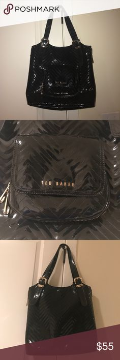 Ted Baker Black Patent Large purse Only used a couple of times. Roomy enough for work but cute enough for play! Black with gold hardware and fun interior floral design. Bag is approx 12 x 14.5 not including handles. Strap drop is approx 10.5 in. Ted Baker Bags