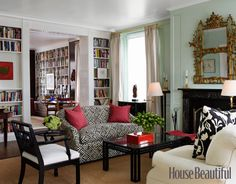 Wall color via housebeautiful.com via designer Todd Klein.  Great graphic black and white fabric on the love seat.