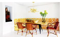 Bright and colorful red and yellow dining space with small plant