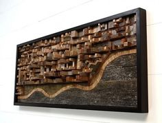 Cityscape in relief made from reclaimed barnwood.