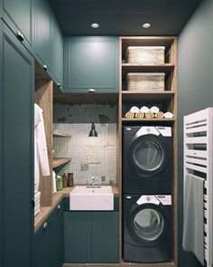We're loving the moody and warm tones of this laundry room! What do you think of this cozy design?