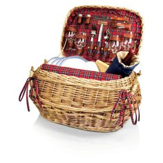 The Highlander picnic basket has old world charm and sophistication like no other basket. This rich chestnut brown willow basket is lined with quilted red tartan cotton and has deluxe service for four