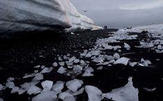 In this Jan. 26, 2015 photo, pieces of thawing ice are scattered along the beachshore at Punta Hanna... - AP Photo/Natacha Pisarenko