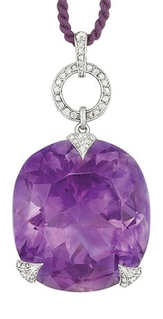 Georges Fouquet - An Art Deco Platinum, Amethyst and Diamond Pendant, France. Centring one cushion-shaped amethyst approximately 78.00 cts., set within a delicate mounting set with rose-cut diamonds, topped by a diamond-set loop joined by a diamond-set pendant loop, with maker's mark and French assay mark, numbered.