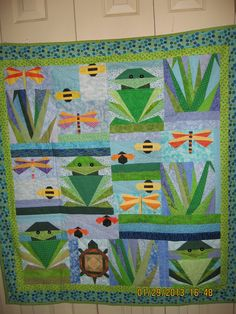 OVER in the POND childs quilt by CANDLERQUILTER on Etsy, $45.00.   I think this night verge direction for the nursery!! Pond/garden like this. :) any of my quilting friends/family ambitious enough to attempt a similar quilt for baby bean?