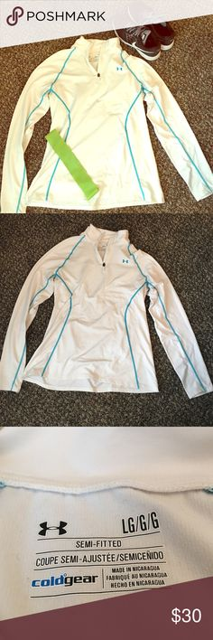 White UnderArmor Quarter Zip White UnderArmor quarter zip. Warm jacket perfect for running in the cold. Inner lining is soft and outer lining is a spandex material. Blue threading is creating designs on the jacket. Under Armour Jackets & Coats
