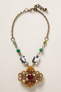 """- By Pam Hiran - Lobster clasp - Brass, metal, agate, hematite, glass, moonstone, acrylic - 20""""L - 3"""" pendant - Imported"""