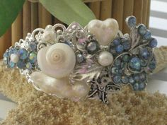 Bridal Ocean Princess Cuff Bracelet Freshwater Pearls, Rinestones, and shell, with an upcycled jewelry piece. Sweet one of a kind freshwater heart shaped pearl tops this sweet bracelet. One of a kind bracelet. by RalstonOriginals, $25.00  at www.RalstonOriginals.etsy.com