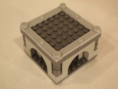 Lego Modular Castle. This Module is used to extend the height of a room module. It has the same system to secure a room or battlement module on top. It can also hold a roof modules.