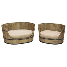 Set of two weathered wood pet beds.       Product: Small and large pet bed    Construction Material: Wood and fabric