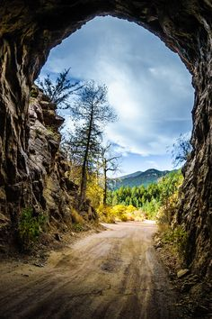 ~~Tunnel on the Gold Camp Road | autumn color and the Rocky Mountains in the distance, Colorado Springs, Colorado | by Delores  Poll~~