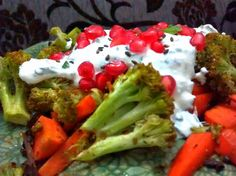 Roasted carrot and broccoli with a mint yoghurt dressing garnished with pomegranate and toasted sesame seeds – puliyogare travels