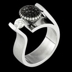 "amazing    ""Confucius Says"" 18ct white gold black and white diamonds, tension set, Award finalist design. MDTdesign"