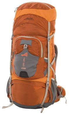 """ALPS Mountaineering Red Tail 4900 Internal Frame Pack, Rust. Top pocket converts to a fanny pack; Rain cover included; Rust, lightweight polyester ripstop; """"Webbing Ladder"""" adjustable harness. Front kangaroo pocket; Front stretch neoprene pocket; Top load w/extendable top lid; Spindrift collar with draw cord. Rescue whistle buckle on sternum strap; Hydration pocket and port; Multiple side compression straps; Lower neoprene side bottle pockets. """"Over The Top"""" compression strap; Lower..."""