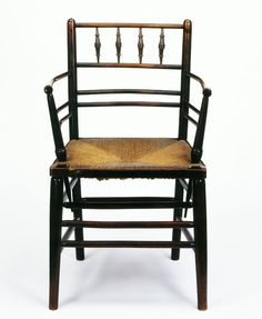 Armchair, ebonised beech, with turned ornament and a rush seat