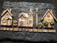 Ceramic houses on sleeper