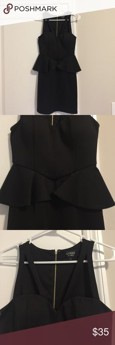 Guess Black Peplum Dress Guess Black Peplum Dress, size 2. Gold zipper down back. Gorgeous dress, only worn once! Guess Dresses Mini