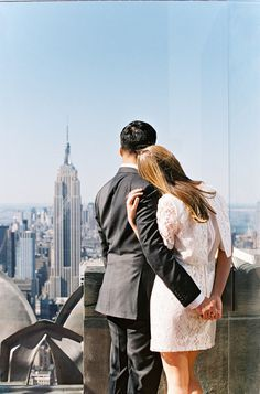 Top of the Rock: http://www.stylemepretty.com/new-york-weddings/new-york-city/2015/06/12/8-charming-engagement-session-spots-in-new-york-city/