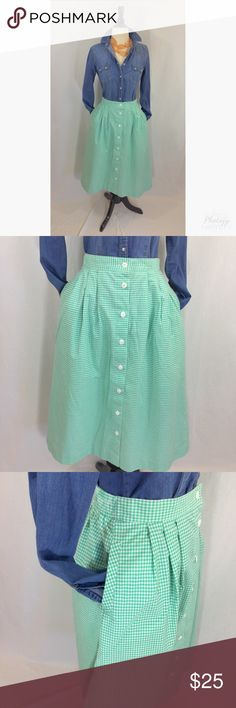 Vintage gingham button front a-line midi skirt Adorable vintage a-line button front green gingham midi skirt with pockets. Size Small. Elastic waistband in back. Loose threads on 2nd button, 29 inches long 26 inch waist not stretched. Shown with chambray shirt and peach necklace also for sale in closet Vintage Skirts Midi