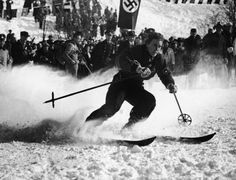 German skier Chistl Cranz competes before a crowd, which includes uniformed Nazis, in the women's alpine combined skiing event during the IV Winter Olympic Games on Feb. 8, 1936, Garmisch-Partenkirchen, Germany. | www.eklectica.in