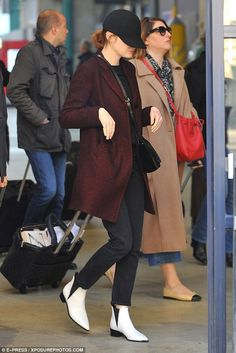 Euro trip! Emma Stone hid beneath a simple hat arriving in Paris Saturday wearing her Acne...