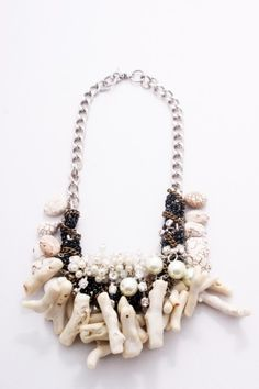 A necklace from Salita Matthew's 2010-11 collection.  Have just ordered one from her 11-12 collection.  It has coral-coloured coral and turquoise in it ... can't wait for it to arrive.