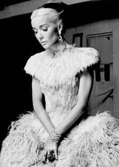 Daphne Guinness in a feathered dress by Alexander McQueen, photographed by David Bailey for Harper's Bazaar, 2011.