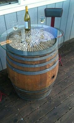 Vintage Wine For the BBQ area but with the glass recessed in. Wine barrel table- love the corks in it! Table Baril, Wine Barrel Furniture, Wine Barrel Table Diy, Whiskey Barrel Table, Wine Table, Barris, Barrel Projects, Wine Cellar Design, Bbq Area