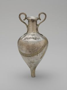 Silver and gilt amphoriskos (scented oil flask)  Period:     Hellenistic Date:     early 3rd century B.C. Culture:     Apulian, possibly Tarentine Medium:     Silver, gold