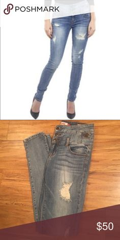 Eunina High Waisted Jeans High Waisted, extremely flattering distressed denim jeans. High quality. Only worn a few times. Eunina Pants Skinny