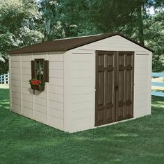 Plastic Resin Storage Sheds. This picture shows a shed with flowers hanging from the window and a brown roof. Suncast Storage Shed, Vinyl Storage Sheds, Vinyl Sheds, Plastic Storage Sheds, Plastic Sheds, Outdoor Storage Sheds, Shed Storage, Built In Storage, Lifetime Storage Sheds