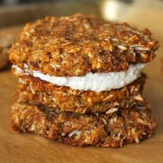 Chewy coconut cookies sweetened with dates and filled with creamy coconut whipped cream. #Glutenfree #paleo #vegan nut-free option.