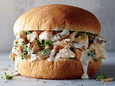 This twist on a classic sandwich swaps the sweet, barbecue-style sauce for a white sauce enriched with nutty Swiss cheese.