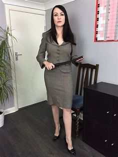 """strict-schoolmistress-needed: """" 'I think we'll start with a bare bottom spanking… Skirt Tumblr, Satin Pleated Skirt, Dress Skirt, Peplum Dress, Sexy Wife, Confident Woman, Female Poses, Costumes For Women, Powerful Women"""