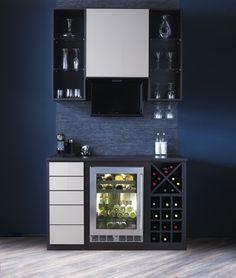 Display your favorite wine and glassware with #custom #shelves around a home minibar. #Shelfie #Entertaining #HomeBar #DesignInspo