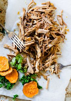 Slow-roasted until the meat falls apart, this juicy, Cuban Pulled Pork recipe makes amazing tacos, burrito bowls and sandwiches. {paleo, crockpot option}