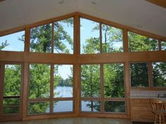 Great Room with a wall of windows overlooking Long Lake of the Three Lakes Chain -- MLS #135727 - 8242 Hull Rd, Three Lakes, WI 54562