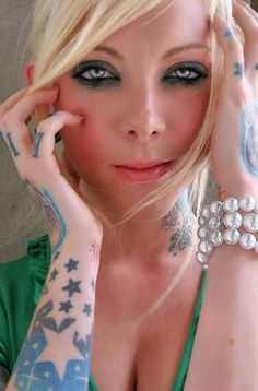 Maria Brink ... In This Moment. Like her makeup and tattoos. Can't wait to see her in concert