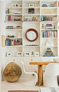 love the mirror hanging at the back of the shelf (I repinned, couldn't find original link.)