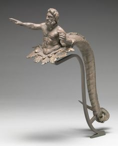 Handle in the Shape of Triton, 100 - 50 B.C.E., Greek, Macedonia or Illyria. J. Paul Getty Museum.