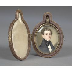 """Miniature Portrait of Edward R. Shotwell by John Wood Dodge, watercolor on ivory, inscribed in pencil on verso, Painted by J.W. Dodge Miniature Painter N.37 Lis[?] St. New York Sept. 33nd, 1833 Ewd. R. Shotwell. A fine bust-length portrait of Mr. Shotwell with wispy hair &  wearing a black suit. In its original brass locket (lacking hair) and silk-lined leather case; 2.25"""" x 1.75"""" (w/o locket), 2.5"""" x 2"""" (w/locket)."""