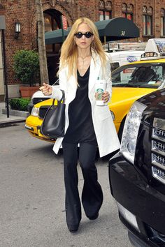 Rachel Zoe, fashion stylist and reality TV star, holds onto a rather large cup of coffee while arriving at a New York City hotel.