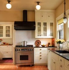Original windows were refurbished. Countertops in the kitchen are black granite with a honed finish. Cabinets are based on original cabinets in the master bedroom. Portland Vintage Plumbing married different faucets and necks to create a unique, historical installation.
