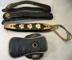 Antique Edo period samurai horse tack, top to bottom, chikara-gawa or gekiso (stirrup straps), sanjakugawa (neck strap), basin or kura tsubo (saddle seat).