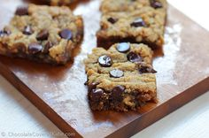 These irresistibly gooey chocolate chip peanut butter bars taste like the lovechild of a chocolate chip cookie and a Reeses peanut butter cup!