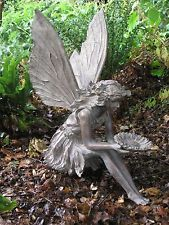 Fairy Sitting with a flower Garden Statue in aged bronze finish. 54cm tall